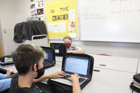 Sixth-grade students Riley Hutton and Jace Jackson work on an assignment as part of Digital Day. Today is the last day of school before Fall Break.