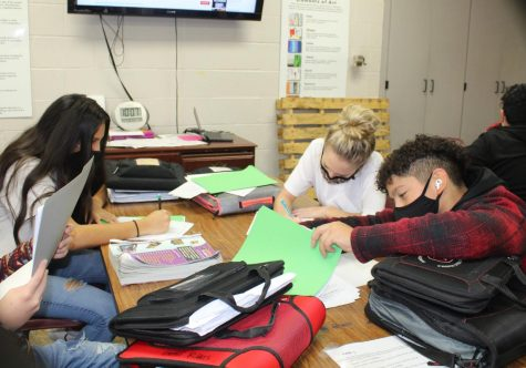 Seventh-grade students work on their comic strips in art class.
