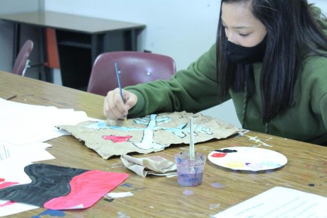 Art students work on pictographs as their latest art project.