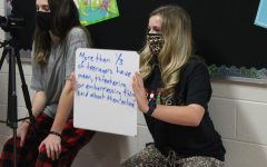 Breckyn Root and Emma Evans film a skit for Anti-Bullying Week.