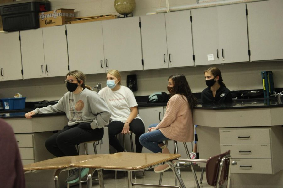 Seventh-grade students listen to instructions during Education Station.