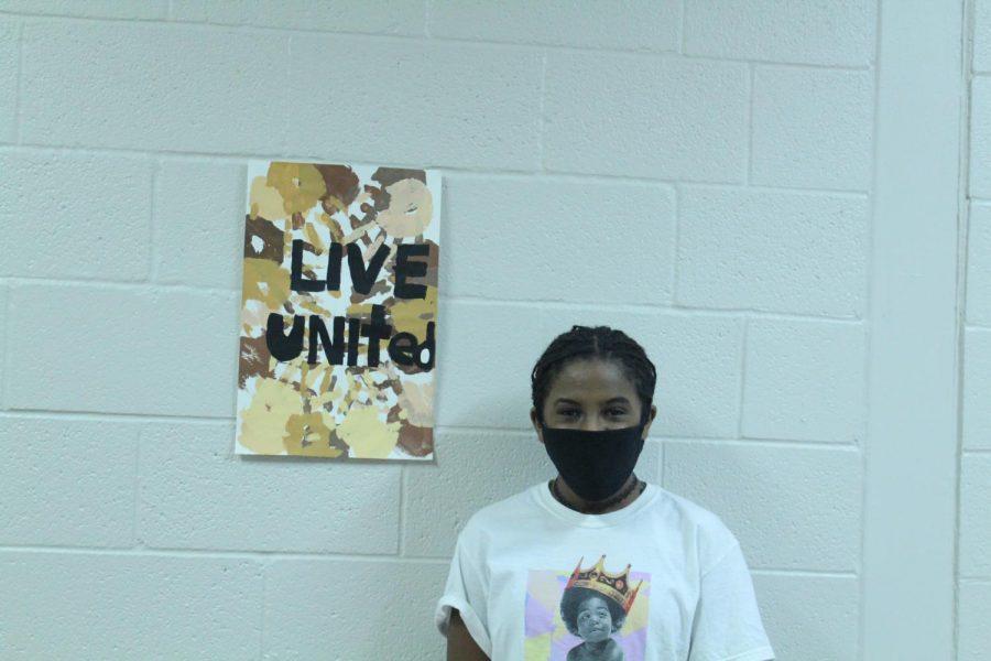 Sitota Mullins shows off her winning art piece.