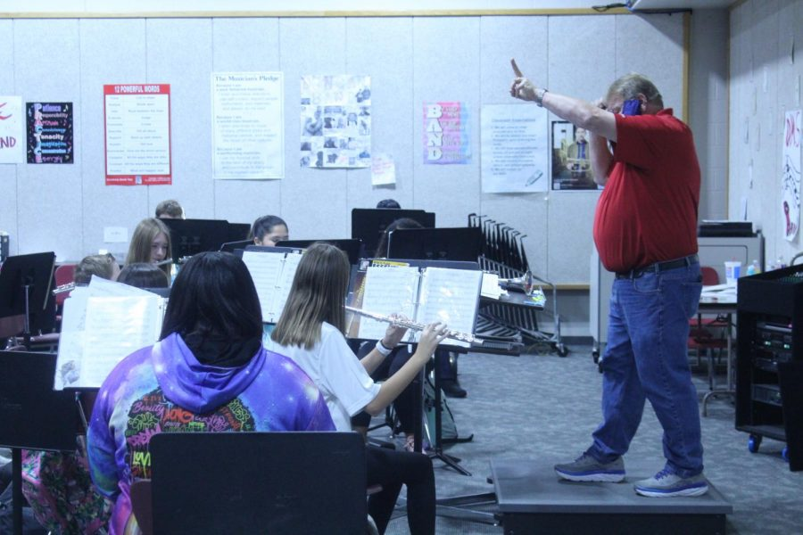 Band director Jeramy Haas gives direction to the band students during practice.