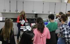 Stacy Smith talks to sixth-grade students during Education Station on Friday.