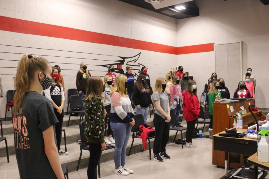 Choir students practice for the Christmas concert, which will be Thursday at the Simmons Center.