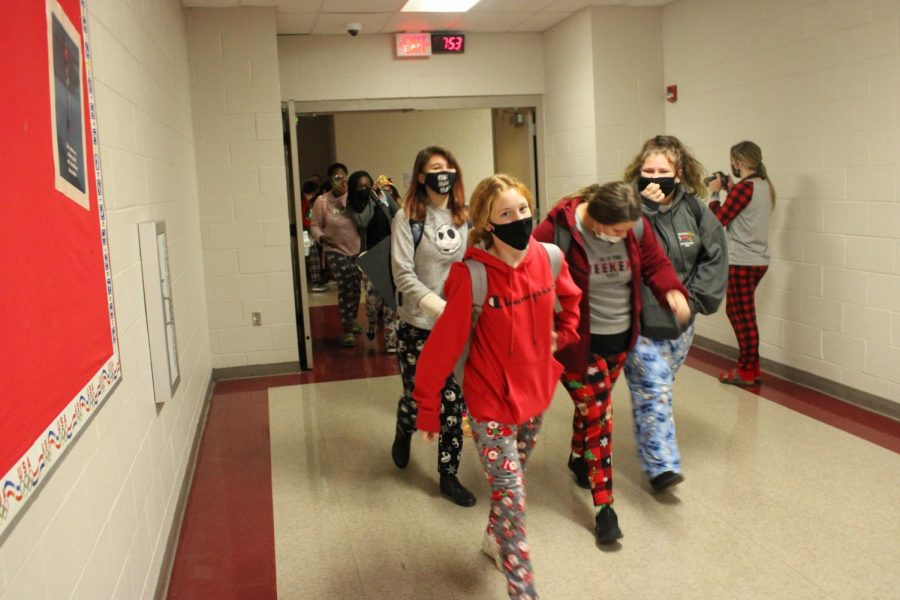 Students participate in a parade in the morning, as they show off their Christmas pajamas.