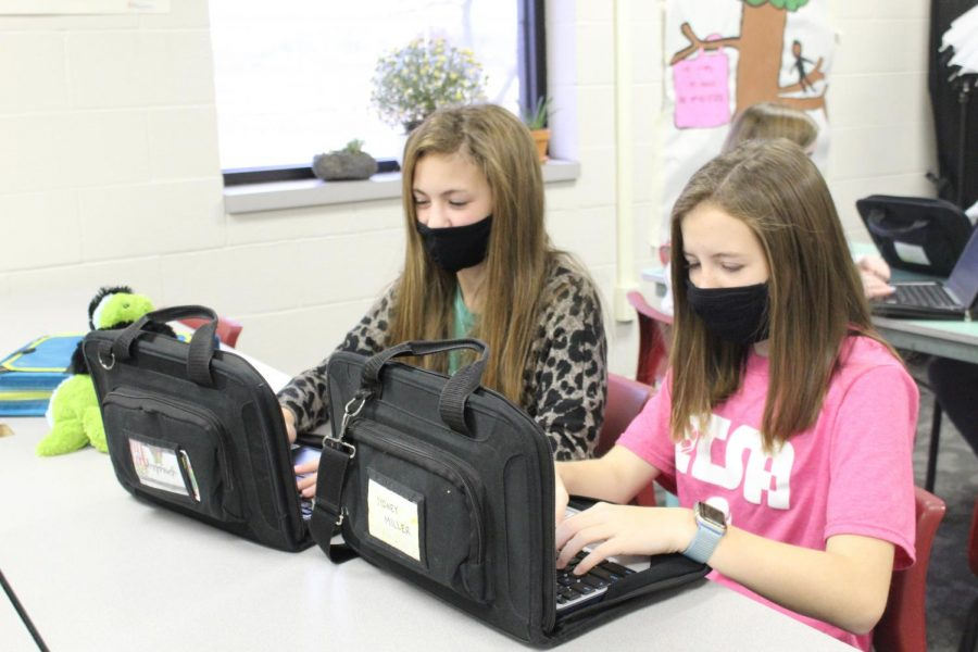 Presley Sanders and Sydney Miller work on their story about in-school quarantine, an idea pushed out by the Oklahoma State Department of Health.