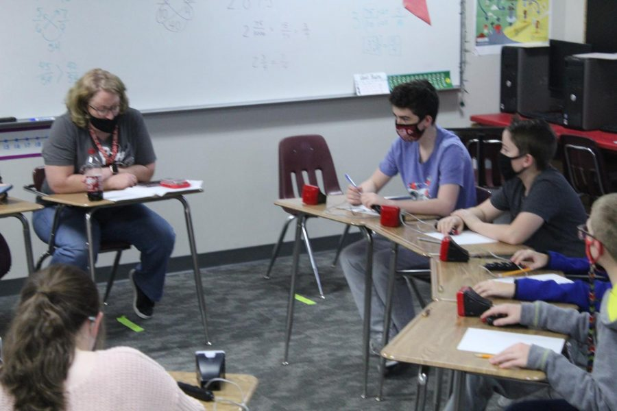 Rosie Castle works with Academic Team members during Thursdays after-school practice.
