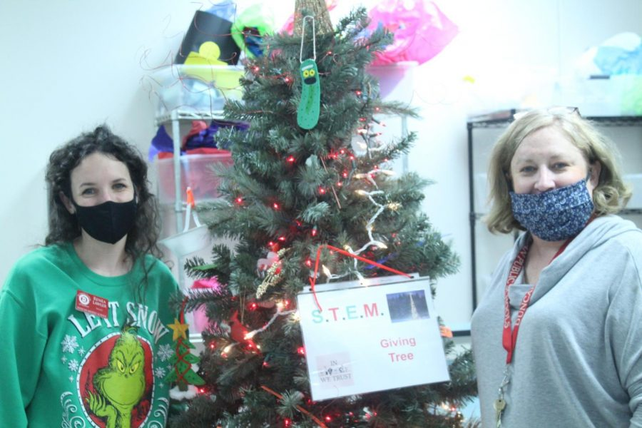 Renea Lawler and Rosie Castle show off the STEM Giving Tree.