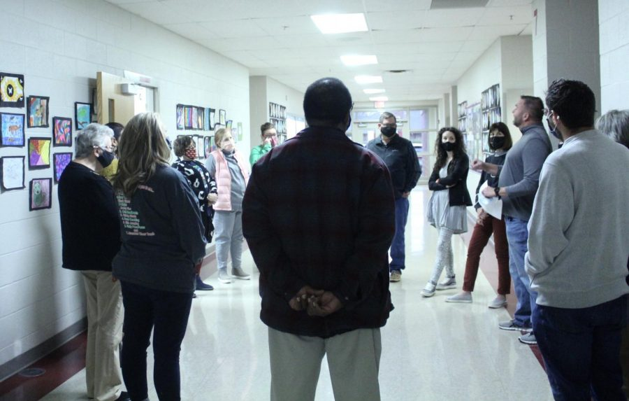 Teachers gather to pray in the Elective Hallway, as part of Gov. Kevin Stitt's Day of Prayer.