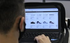 Jackson Lohrer, seventh-grader, looks up different shoe styles online. At DMS, there are plenty of students ready to show off their shoe game.