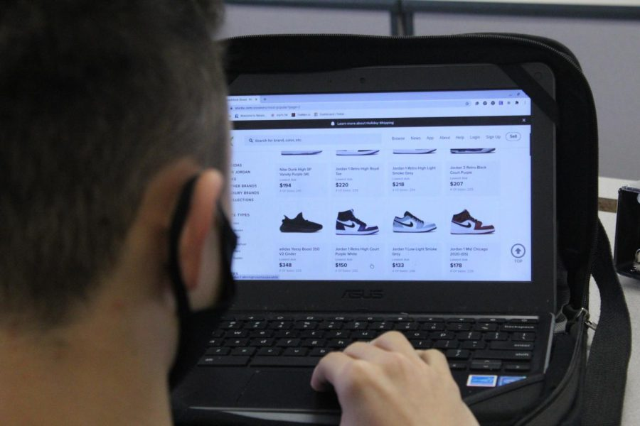 Jackson+Lohrer%2C+seventh-grader%2C+looks+up+different+shoe+styles+online.+At+DMS%2C+there+are+plenty+of+students+ready+to+show+off+their+shoe+game.