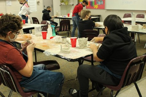 Andrew Gaither and Dawson Ellison, both seventh-graders, design pottery projects in art class.