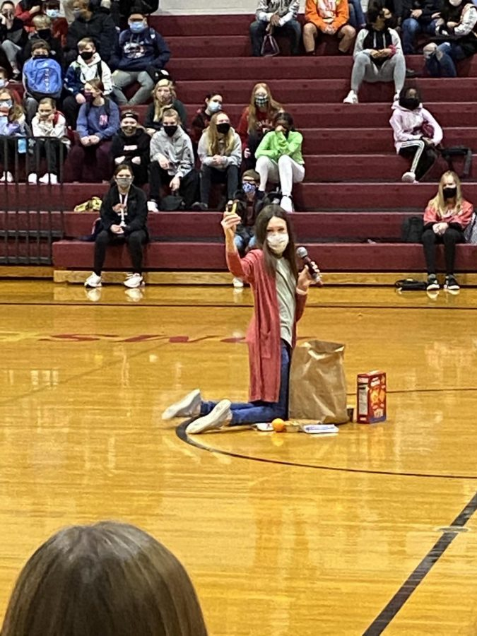 Ava Miller shows what kinds of food goes into the usual Supper Club bag. The National Junior Honor Society is hosting a food drive to help the DMS food pantry.