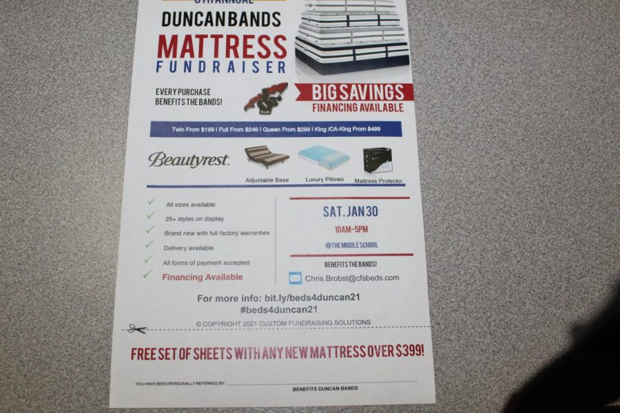 A flyer announces the band mattress sale. The sale is Saturday.