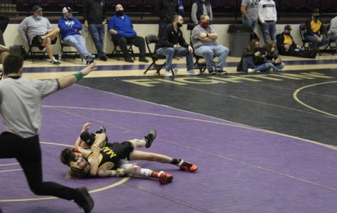 Jack Ensey gets an opponent in hold during the Chickasha Wrestling Tournament.
