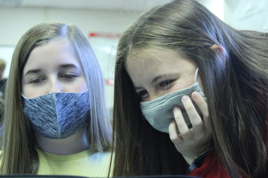 Katelyn Young and Sydney Miller wear masks during newspaper class. Duncan Public Schools passed a mask mandate before the start of the school year in response to the COVID-19 pandemic.