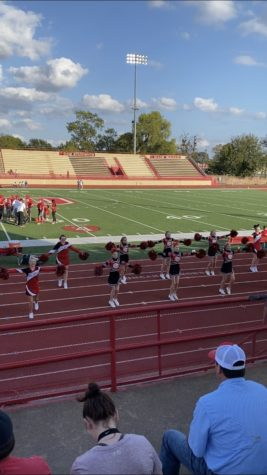 Duncan Middle School cheerleaders cheer during a football game.