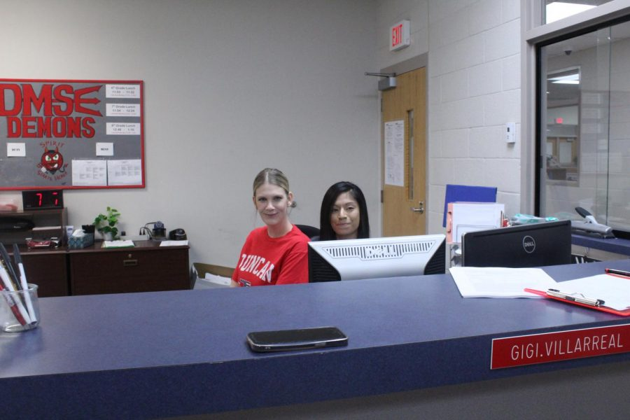 DMS clerks Alex Stewart and Gigi Villarreal pose for a photo prior to Labor Day weekend.